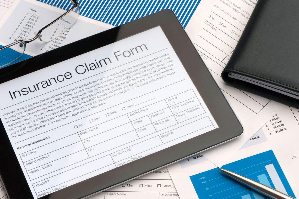 Online insurance claim form on a digital tablet